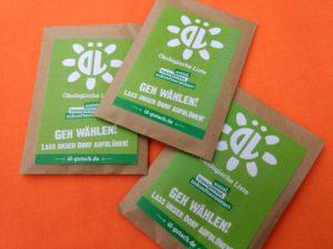 Drei Saatguttütchen bedruckt mit dem ÖL-Logo und dem folgenden Text: Ökologische Liste - sozial, transparent, zukunftsorientiert; Geh wählen! Lass unser Dort aufblühen!; öl-gutach.de